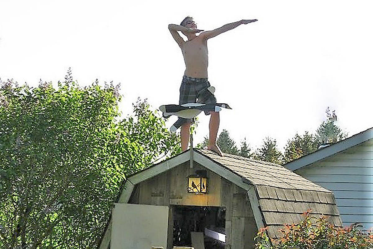 """Shirley Sawatsky took this picture in her Aldergrove backyard of her grandson, 22-year-old Jacob Sawatsky, mimicking a weather vane. """"His future is as straight as an arrow,"""" predicts grandma. (Special to Langley Advance Times)"""