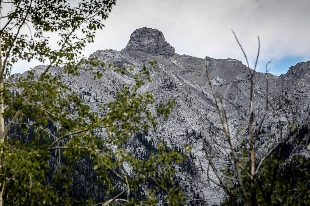 Momentum is building to properly name a prominent landmark on a mountain in the Alberta Rockies, shown near Canmore, Alta., on Thursday, Sept.3, 2020, because its commonly used nickname is racist and misogynistic. The feature, which has been known since the 1920s as Squaw's Tit, is located near the summit on Mount Charles Stewart and can be seen from the mountain town of Canmore. THE CANADIAN PRESS/Jeff McIntosh