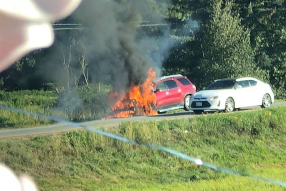 An SUV on fire in the westbound lanes of Highway 1 near the No. 3 Road exit, between Chilliwack and Abbotsford, Sept. 8, 2020. (Facebook/Dee Hiles)