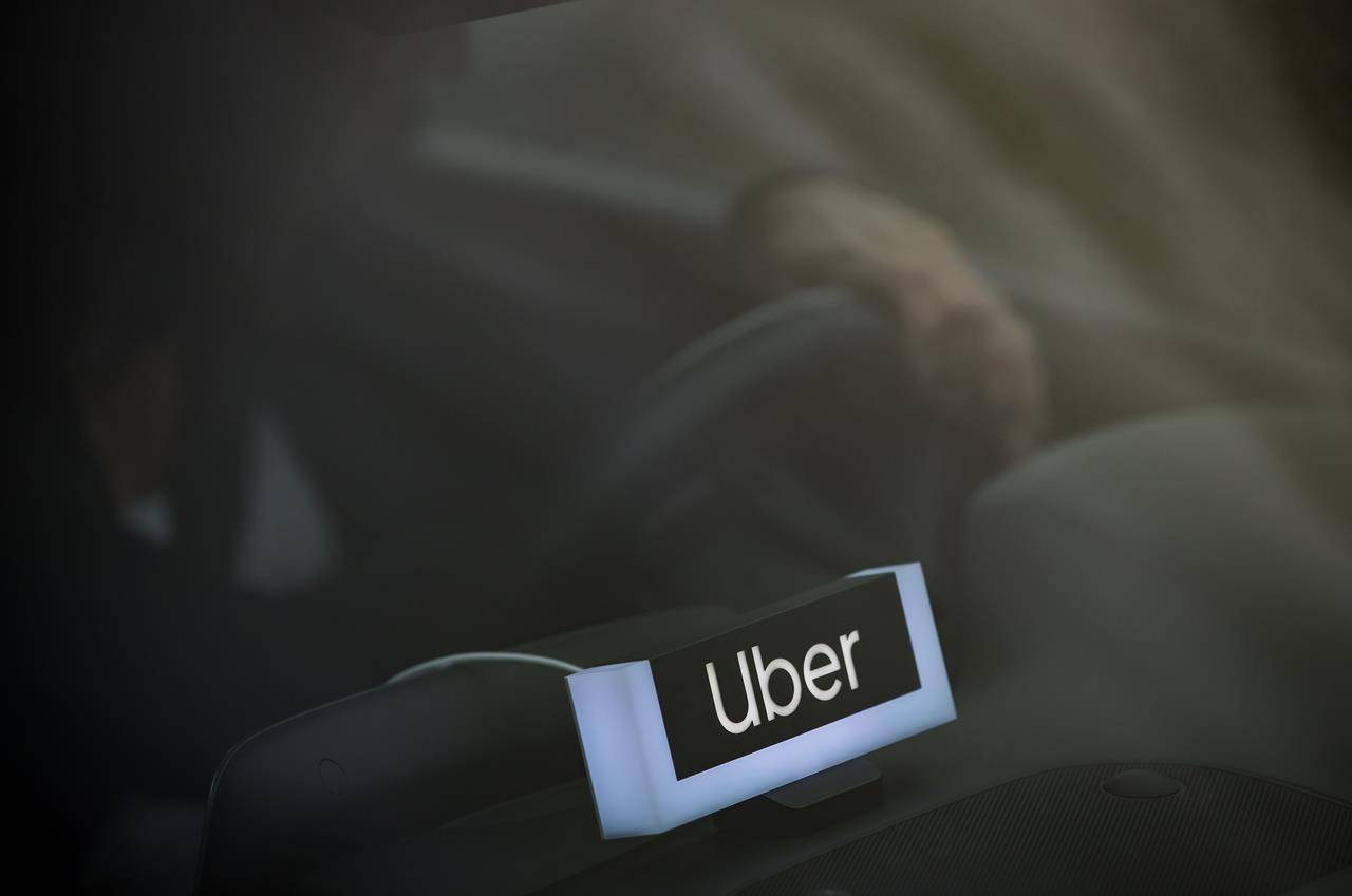 An Uber driver is seen in Vancouver, Friday, Jan. 24, 2020. Uber Technologies Inc. is launching a handful of sustainability measures in Canada to help it reach lofty goals it has set for the market and beyond. THE CANADIAN PRESS/Darryl Dyck