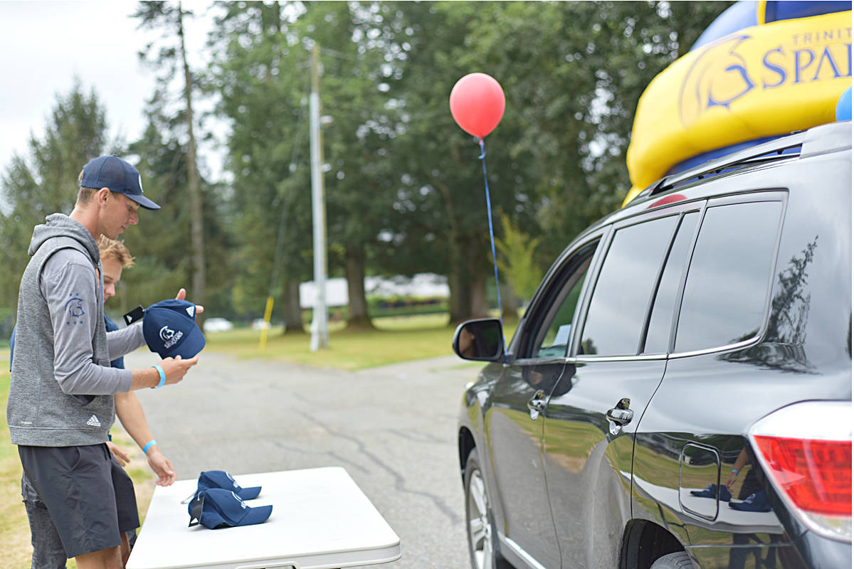 New students at Trinity Western University in Langley had a different type of orientation day during a drive-through event on campus on the Sept. 5 weekend. (TWU/Special to Langley Advance Times)