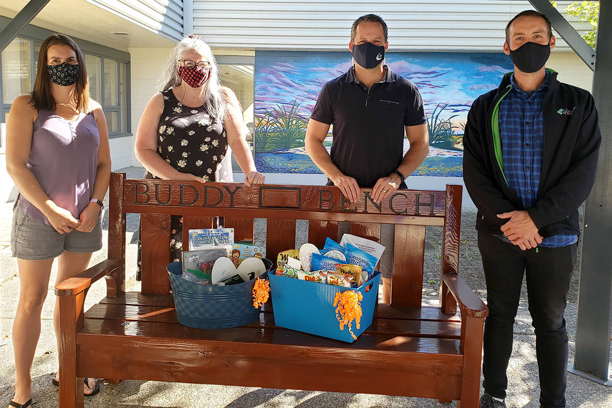 Lindsay Romas and Donna Robertson presents School Staff Appreciation Baskets to Chris Wijr and Mark Touzeau, principal and vice principal at Shortreed Community Elementary. (Val Hiebert/Special to the Star)