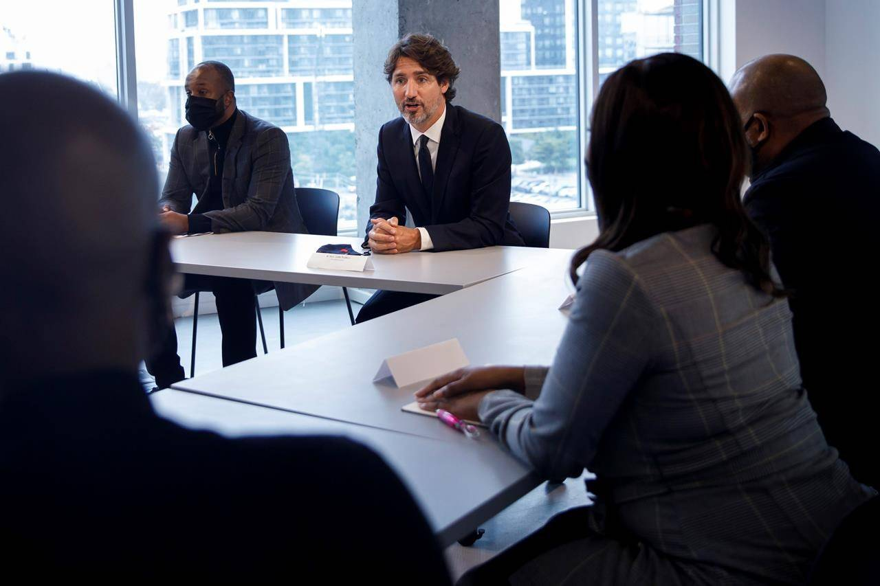 Prime Minister Justin Trudeau sits alongside HXOUSE co-founder Ahmed Ismail, as he meets with Black entrepreneurs at HXOUSE in Toronto, Wednesday, Sept. 9, 2020. THE CANADIAN PRESS/Cole Burston