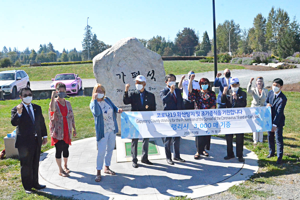 Local authorities, South Korean war veterans, and Korean consular officials thanked a Vancouver Rotarian and the County of Gapyeong for arranging a donation of masks to Langley. (Matthew Claxton/Langley Advance Times)
