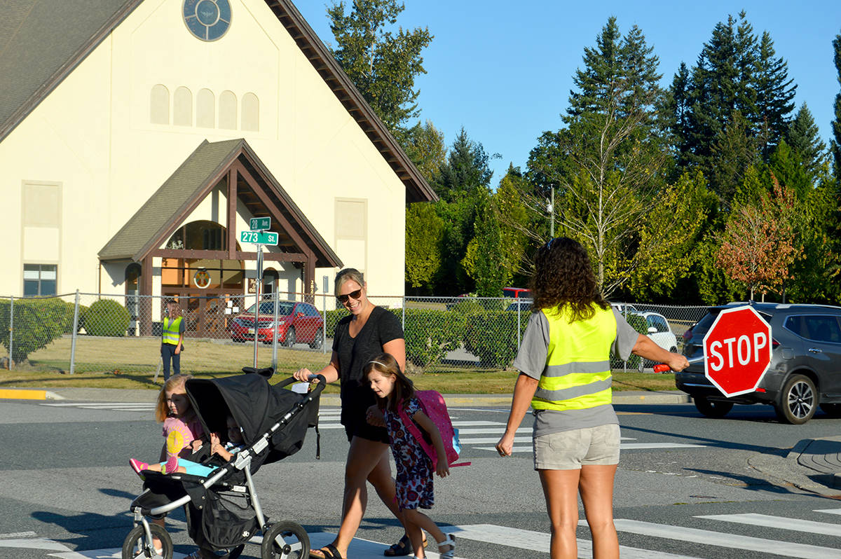 Parents and students head to Shortreed Community School on Thursday morning for the first of two days focused on COVID-19 safety in the classroom. (Ryan Uytdewilligen/Aldergrove Star)