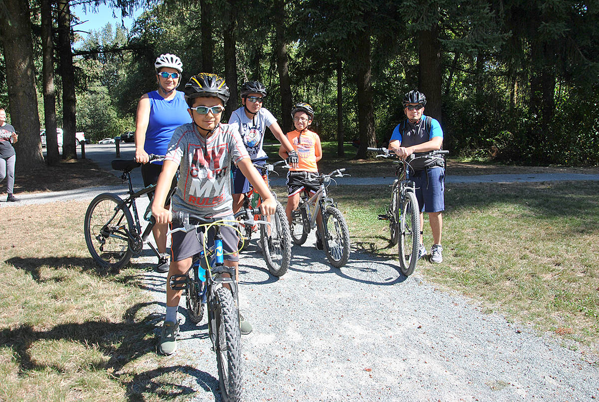 "The five-member Rivas family made their third trek of the summer from Surrey's Panorama Ridge to Aldergrove Regional Park for a Labour Day cycle. ""We love the trails,"" said Salvador, noting they usually go for an hour and a half long excursion with their sons, ages 10 and 11, every weekend at different locations in the Lower Mainland. (Roxanne Hooper/Aldergrove Star)"