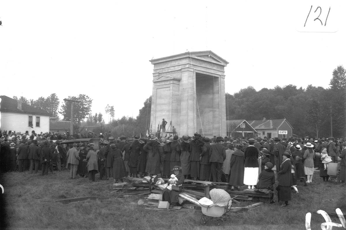 This photo was taken by Vancouver photographer Walter Calder in 1921, at the first of three dedication ceremonies held for the Peace Arch monument. With the 100th anniversary of the ceremony approaching, a group based in Blaine, Wash., is lobbying postal agencies on both sides of the border to create a commemorative stamp. (White Rock Museum and Archives photo)