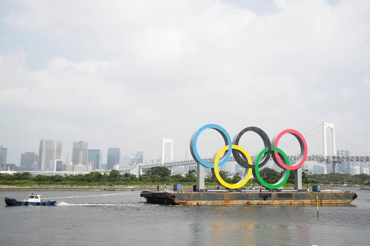 A tugboat moves a symbol installed for the Olympic and Paralympic Games Tokyo 2020 on a barge moved away from its usual spot off the Odaiba Marine Park in Tokyo Thursday, Aug. 6, 2020. Olympic trampoline champion Rosie MacLennan can envision the Tokyo Games going ahead next summer without a COVID-19 vaccine because the NHL, NBA and professional tennis are so far providing successful templates to hold sports events during a pandemic. THE CANADIAN PRESS/AP, Hiro Komae