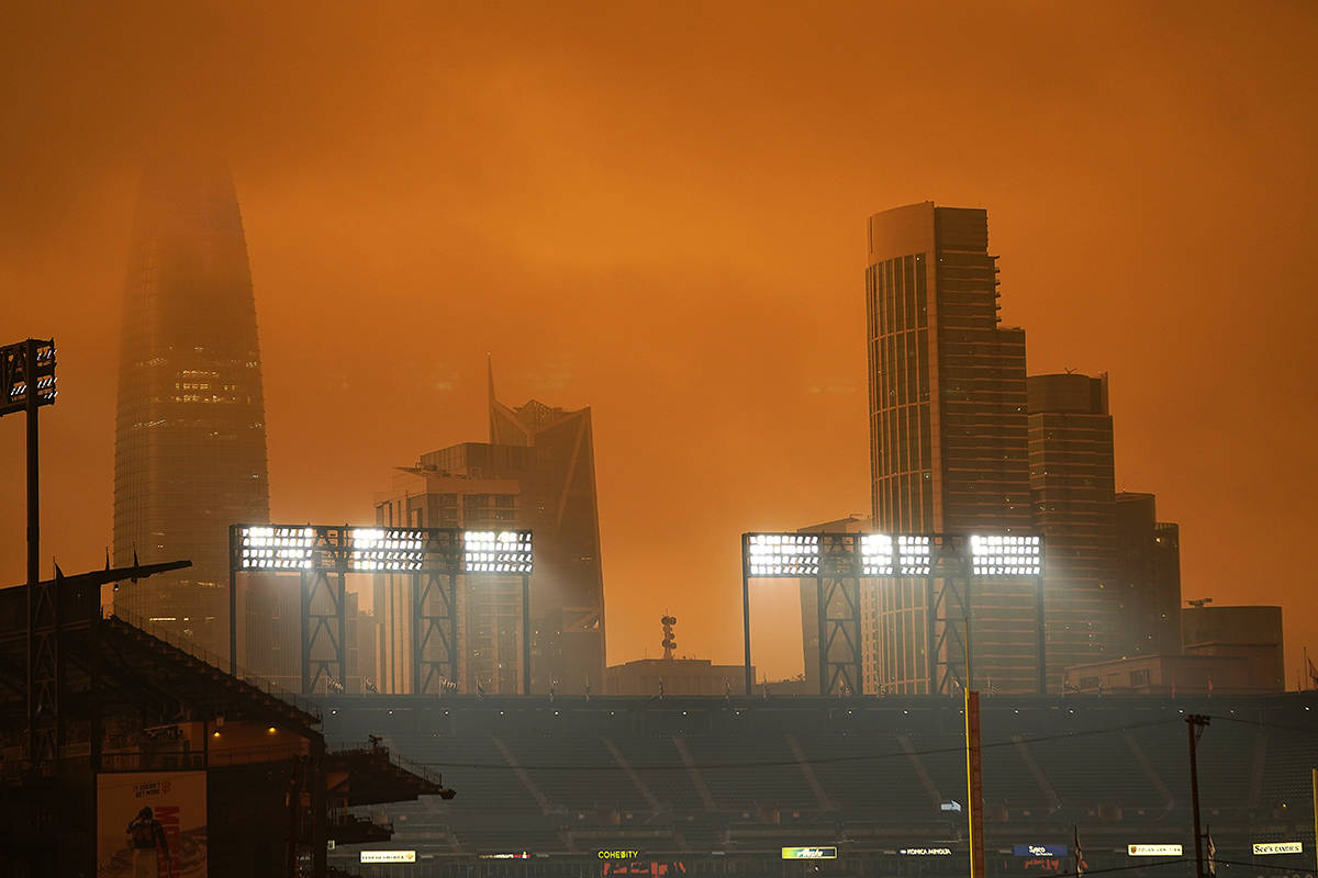 The skyline in the distance behind Oracle Park is partially visible with smoke from wildfires late Wednesday afternoon Sept. 9, 2020, in San Francisco. (AP Photo/Tony Avelar)