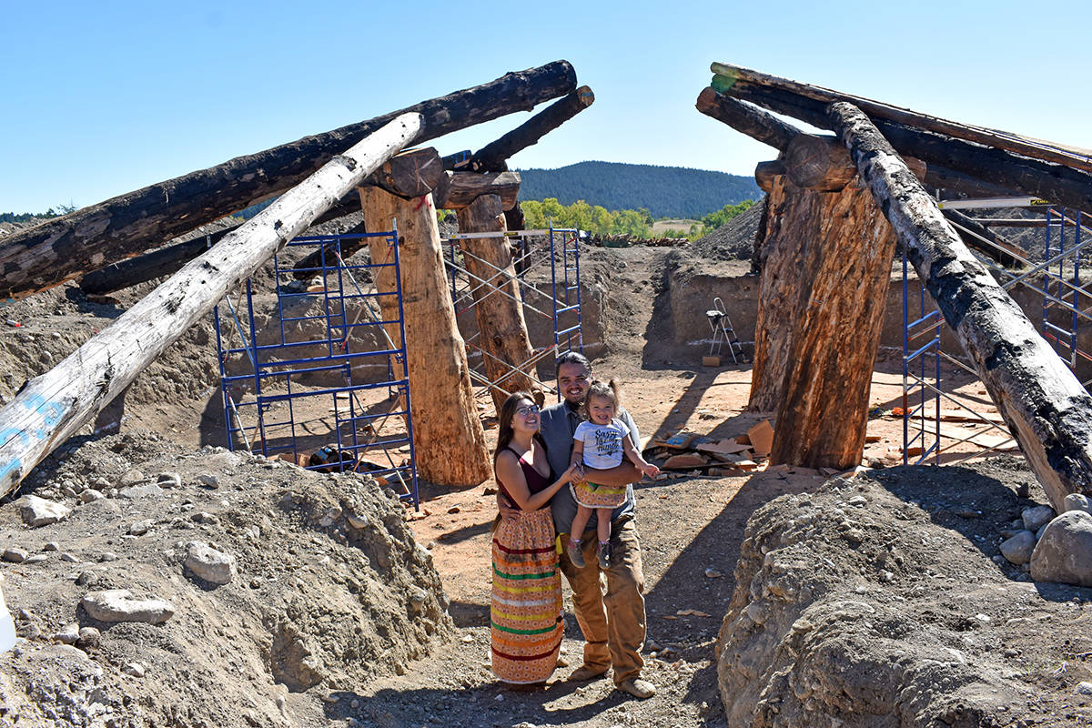 Loretta Jeff Combs and Peyal Laceese with their daughter Nildziyenhiyah stand in front of their pit house which they hope to be able to move into next spring. (Rebecca Dyok photo)