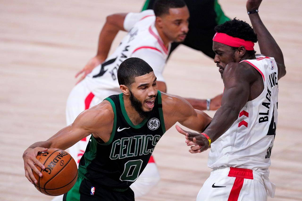 Boston Celtics' Jayson Tatum (0) drives against Toronto Raptors' Pascal Siakam during the second half of an NBA conference semifinal playoff basketball game Friday, Sept. 11, 2020, in Lake Buena Vista, Fla. (AP Photo/Mark J. Terrill)