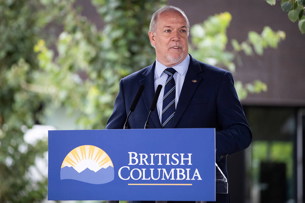 FILE – British Columbia Premier John Horgan speaks during an announcement about a new regional cancer centre, in Surrey, B.C., Thursday, Aug. 6, 2020. THE CANADIAN PRESS/Darryl Dyck