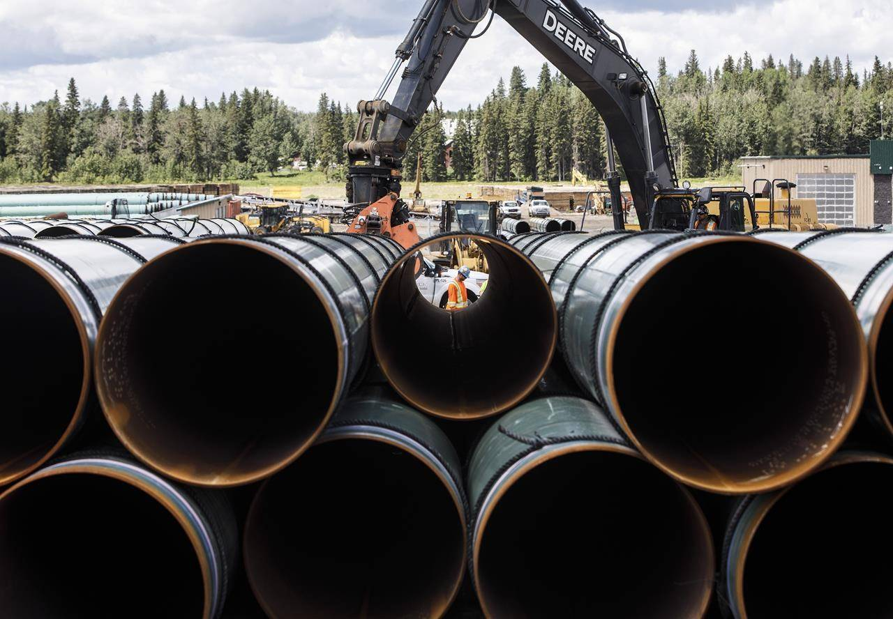 Pipe for the Trans Mountain pipeline is unloaded in Edson, Alta. on Tuesday, June 18, 2019. Statistics Canada says that capital spending in the Canadian oil and gas sector fell by 54 per cent in the second quarter ended June 30, as oil prices fell due to a global price war and demand destruction caused by the COVID-19 pandemic. THE CANADIAN PRESS/Jason Franson