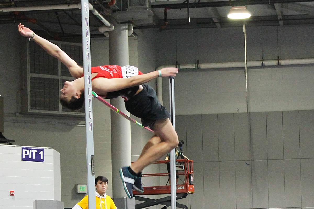 Langley Mustangs jumper Jake Schmidt clears the bar at the University of Washington high school indoor invitational track meet in Seattle in February. It was the only meet the club attended before the pandemic shut down athletic competition (Special to Langley Advance Times)