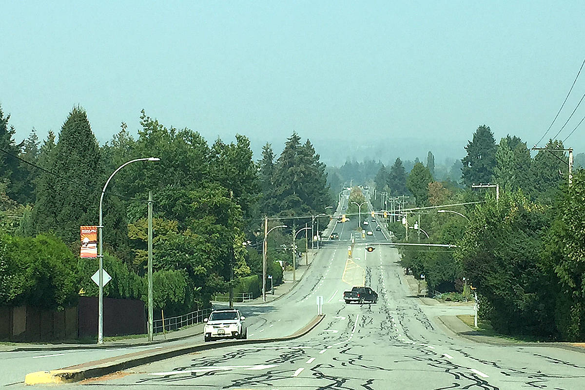 Looking north towards Willoughby, Walnut Grove, and even the Golden Ears mountain in Maple Ridge, the thick smoke from the U.S. wildfires obscure the normal view available from the 208th Street hill in the Uplands neighbourhood of Langley City. (Roxanne Hooper/Langley Advance Times)