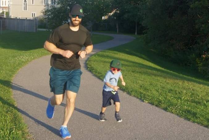 Jeff Clarkson and his son Logan, 3, go for a run in an undated handout photo. THE CANADIAN PRESS/HO-Kari Clarkson, *MANDATORY CREDIT*