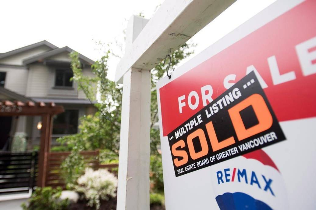 A real estate sign is pictured in Vancouver, B.C., Tuesday, June, 12, 2018. The Canadian Real Estate Association says home sales in August climbed 6.2 per cent compared with July to hit an all-time monthly record with gains led by the Greater Toronto Area and B.C.'s Lower Mainland. THE CANADIAN PRESS Jonathan Hayward