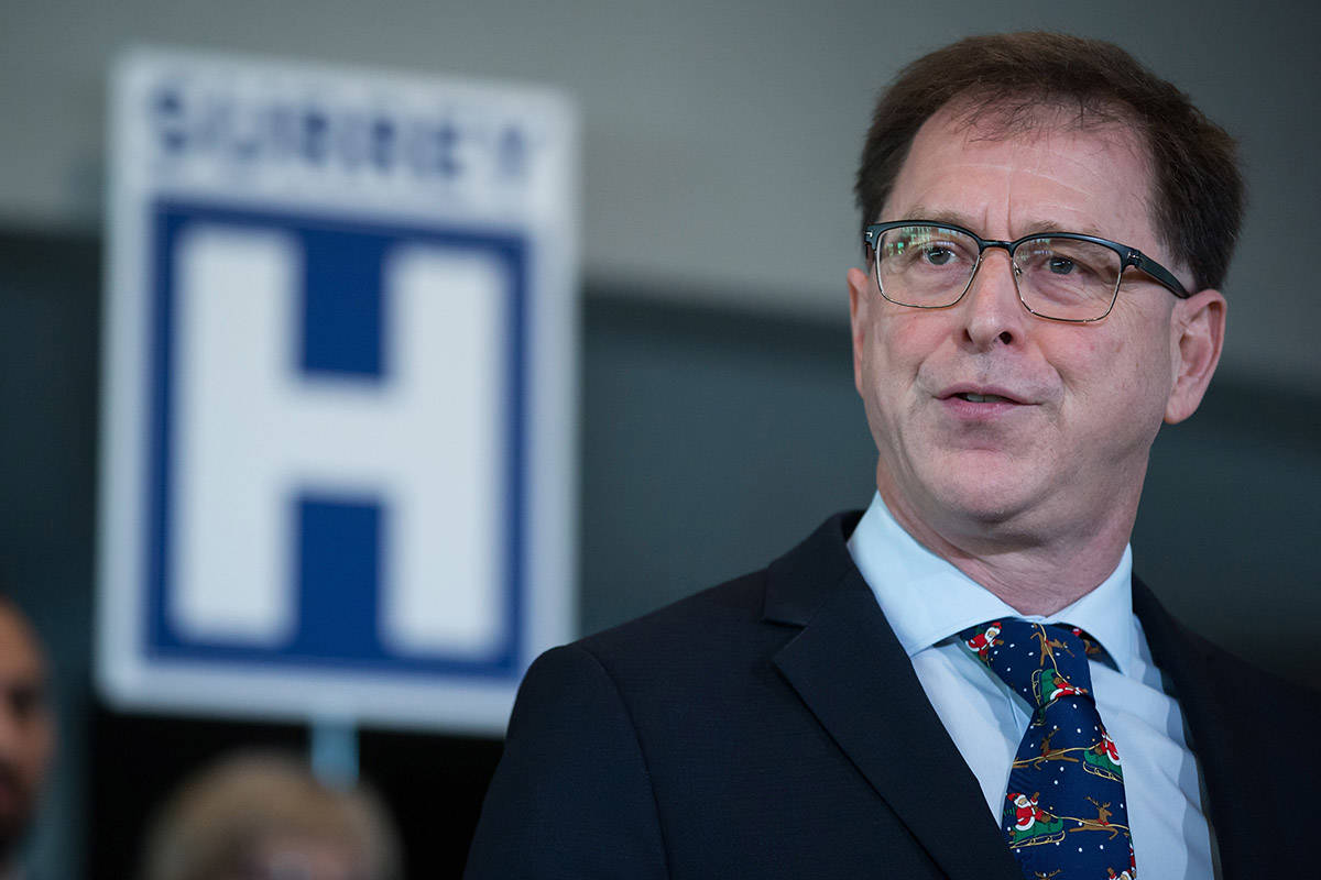 FILE – British Columbia Health Minister Adrian Dix speaks before Premier John Horgan announces a new hospital would be built in Surrey, B.C., on Monday December 9, 2019. THE CANADIAN PRESS/Darryl Dyck