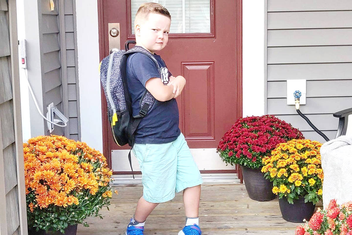 """Caleb did his """"super cool guy"""" pose on the way to his first day of class. (Katie Trondsen/Special to the Langley Advance Times)."""
