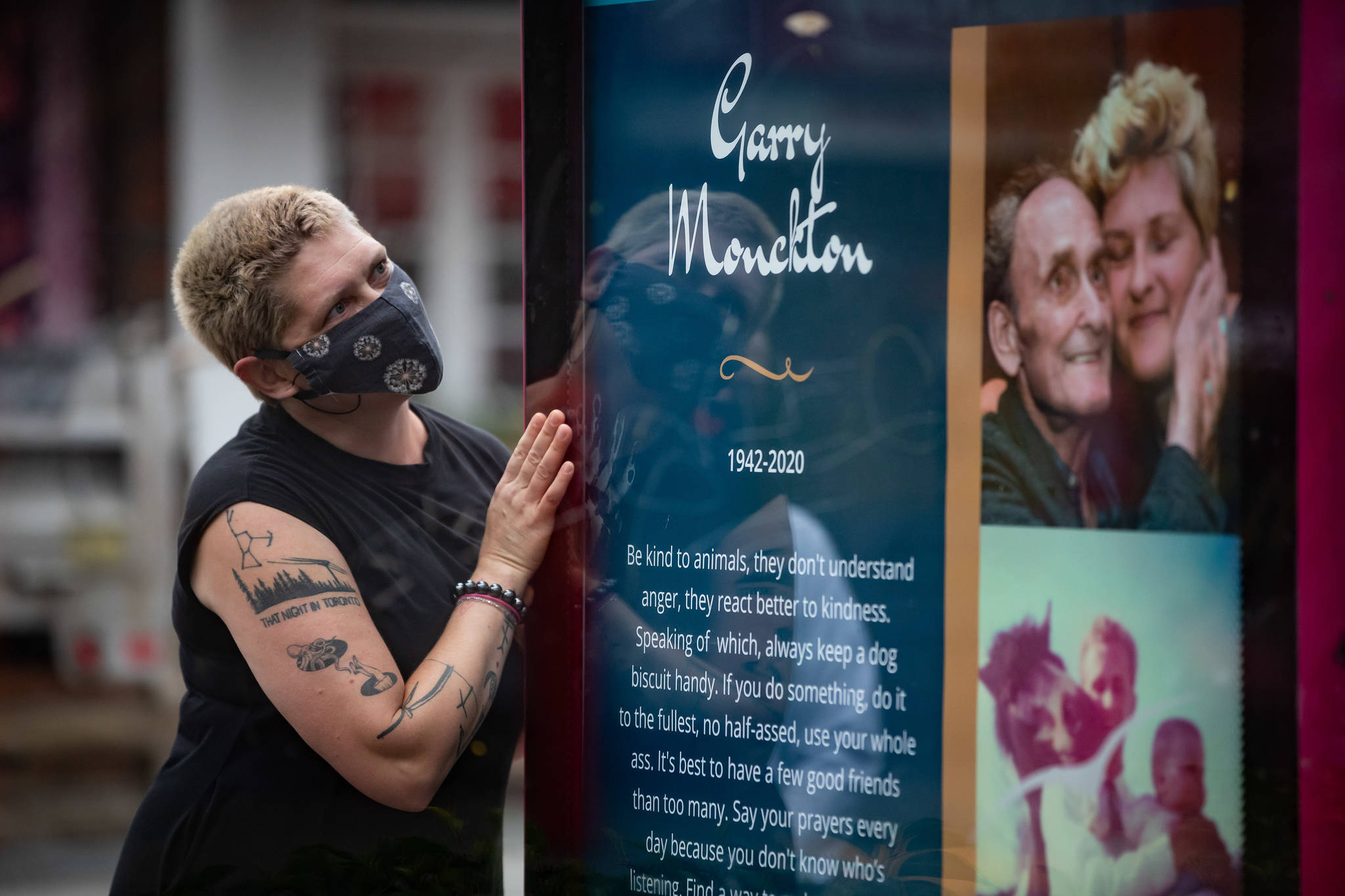 Samantha Monckton pauses after unveiling a memorial for her late 77-year-old father Garry Monckton, who died in April after becoming infected with COVID-19, in Vancouver, B.C., Tuesday, Sept. 15, 2020. The tribute to Monckton is the first of a series of memorial posters paying tribute to residents of Vancouver's West End who have died from COVID-19. THE CANADIAN PRESS/Darryl Dyck