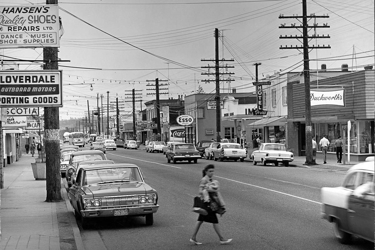 A woman crosses 176 Street in a photo circa 1961. Duckworth's and the Cloverdale Hotel can be seen on the right. Paul Orazietti, executive director for the Cloverdale BIA, said he's installing decorative lighting, much like the lighting seen in the photo, across 176th Street. (Courtesy of the Surrey Archives / 180.1.85)
