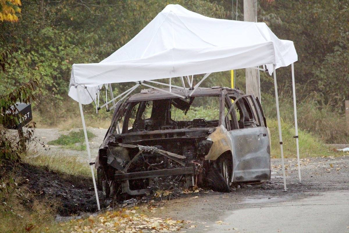 Police were also at the scene of a burned-out vehicle Friday (Sept. 18) morning, in the 18100-block of 12 Avenue. (Tracy Holmes photo)