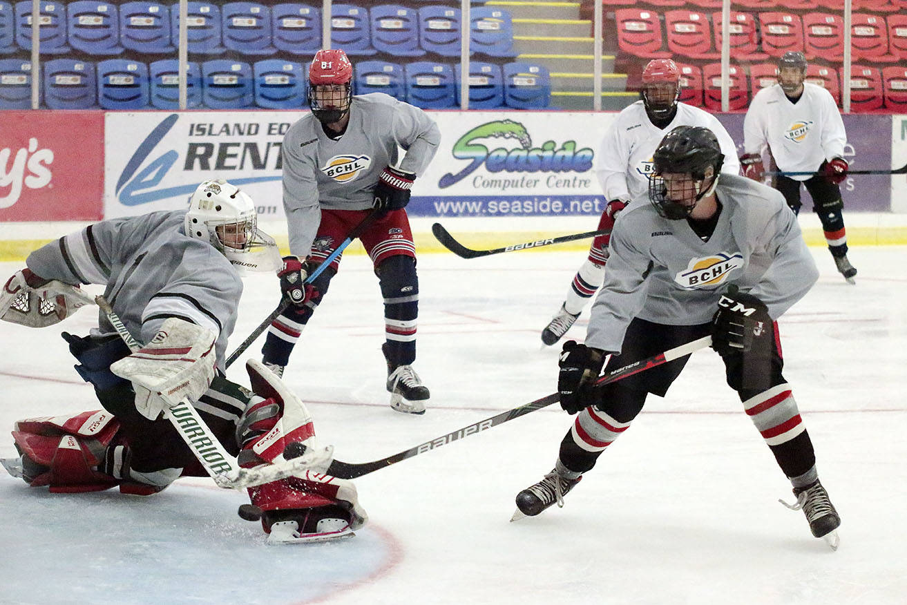 Cowichan Valley Capitals prospects clash during a 3-on-3 scrimmage at the Cowichan Valley Capitals rookie ID camp on Saturday. (Kevin Rothbauer/Citizen)