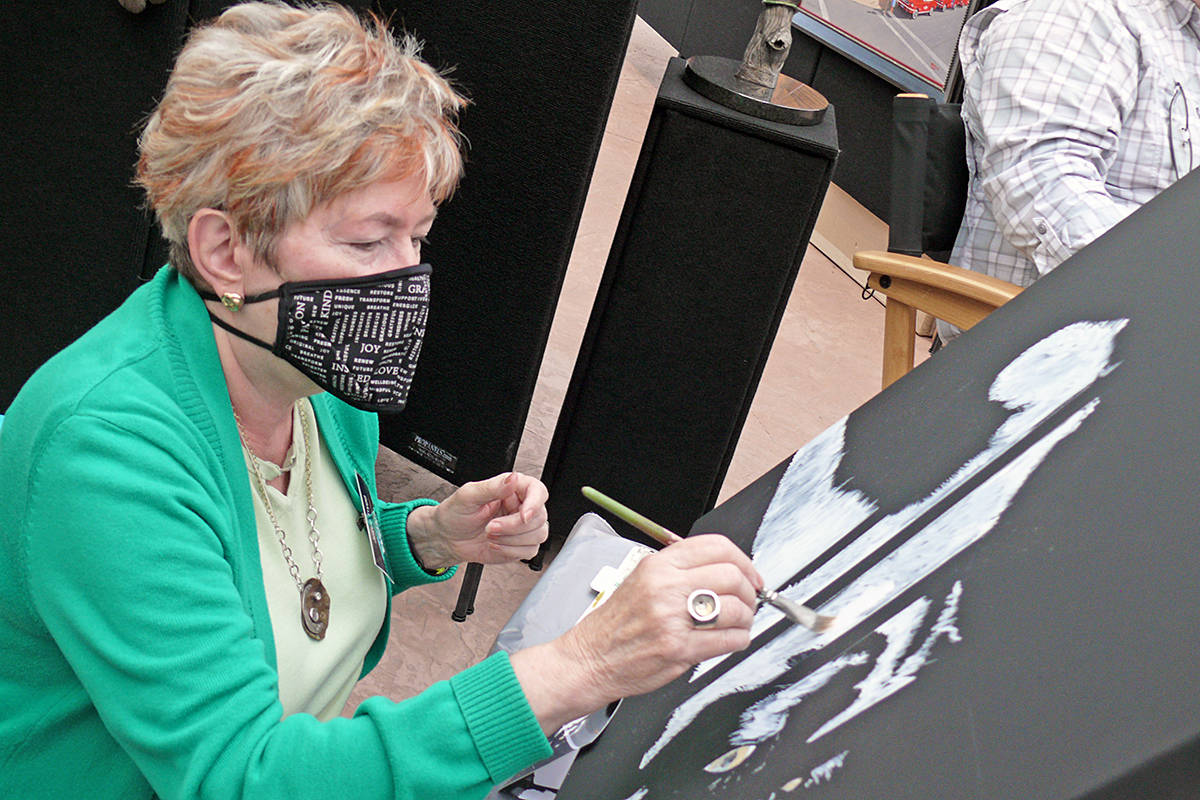 Fort Langley artist Joyce Trygg worked with a mask at the West Fine Art Show held on Sept. 18-20, 2020 at the Glass House Estate Winery on 0 Avenue. (Dan Ferguson/Langley Advance Times)