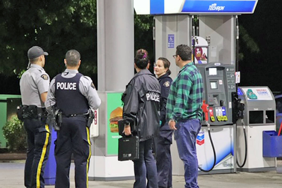 RCMP at the scene of a report of shots fired at the Chevron station near 232 Street and 72nd Avenue Saturday night, Sept. 20, 2020 (Shane MacKichan/Special to Langley Advance Times)