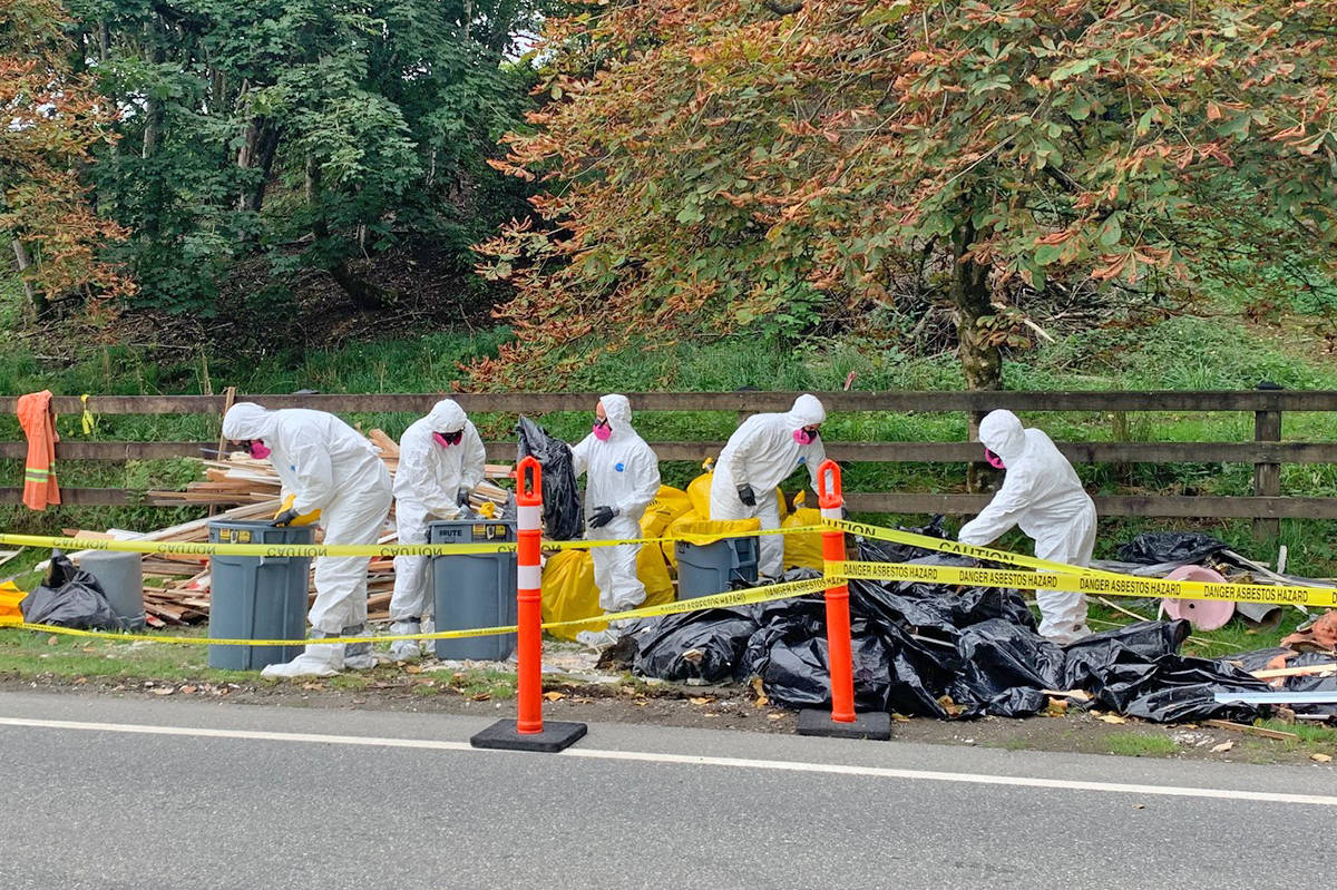 Township crews work on an illicit roadside dump site in the 23500 block of Rawlison Cres. on Sept. 1, 2020, one of six in three weeks that have cost $60,000 in cleanup costs (Special to Langley Advance Times)