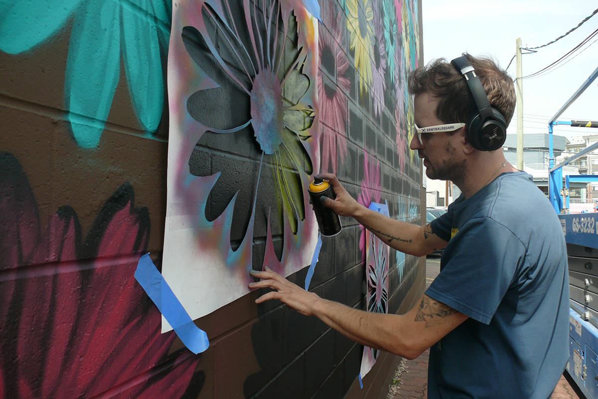 Fort Langley resident Alex Stewart, 33, completed is latest mural as part of the Downtown Langley Business Association Mural Walk on Sept. 15, 2020. (Dan Ferguson/Langley Advance Times)