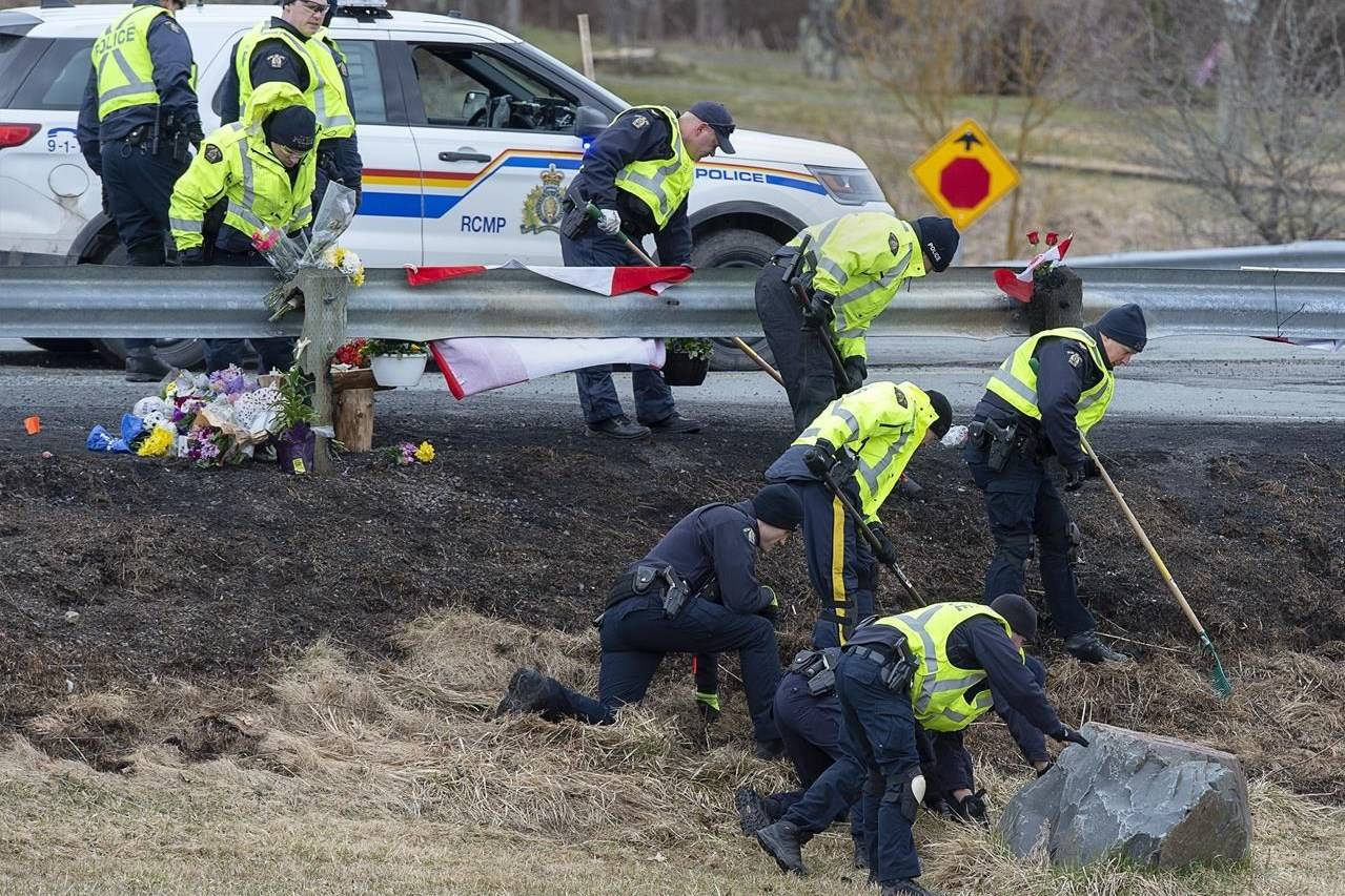 RCMP investigators search for evidence at the location where Const. Heidi Stevenson was killed along the highway in Shubenacadie, N.S. on Thursday, April 23, 2020. Court documents released today describe the violence a Nova Scotia mass killer inflicted on his father years before his rampage, as well as the gunman's growing paranoia before the outburst of shootings and killings.THE CANADIAN PRESS/Andrew Vaughan