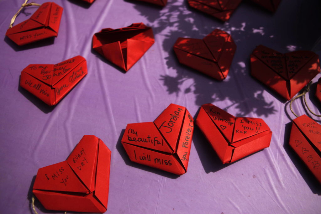 Heartfelt messages are left on a table as people come out to mark International Overdose Awareness Day during a mass group naloxone training seminar at Centennial Square in Victoria, B.C., on Saturday August 31, 2019. THE CANADIAN PRESS/Chad Hipolito