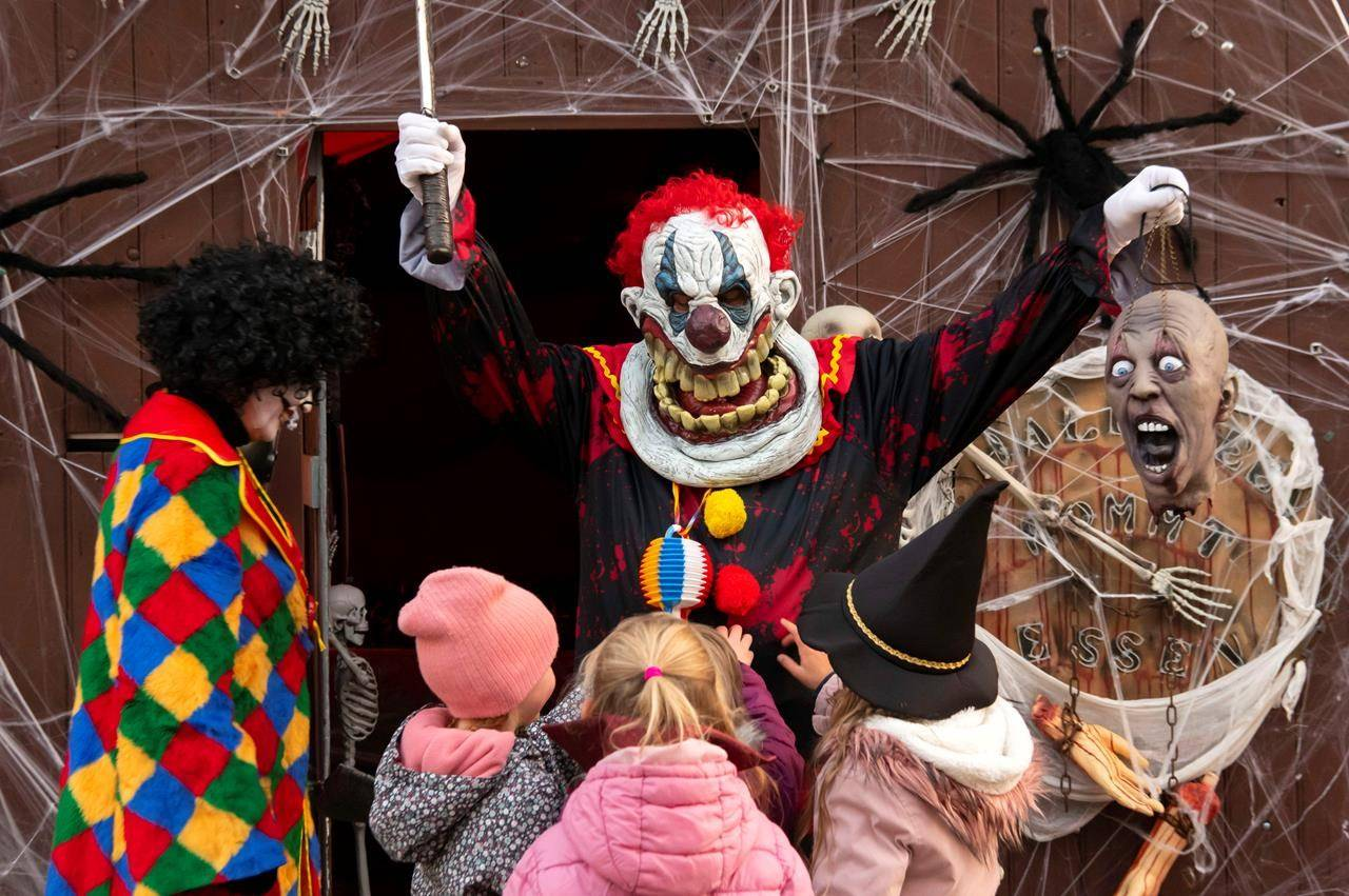 People wear costumes at a house decorated for Halloween in Walschleben near Erfurt, Germany, Thursday, Oct. 31, 2019. THE CANADIAN PRESS/AP/Jens Meyer
