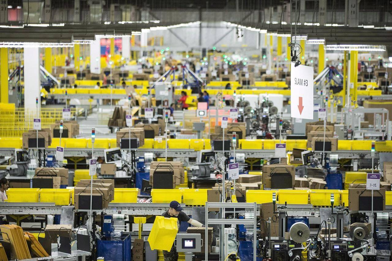 Employees work at the Amazon fulfillment centre in Brampton, Ont. on Monday, November 26, 2018. THE CANADIAN PRESS/Chris Young