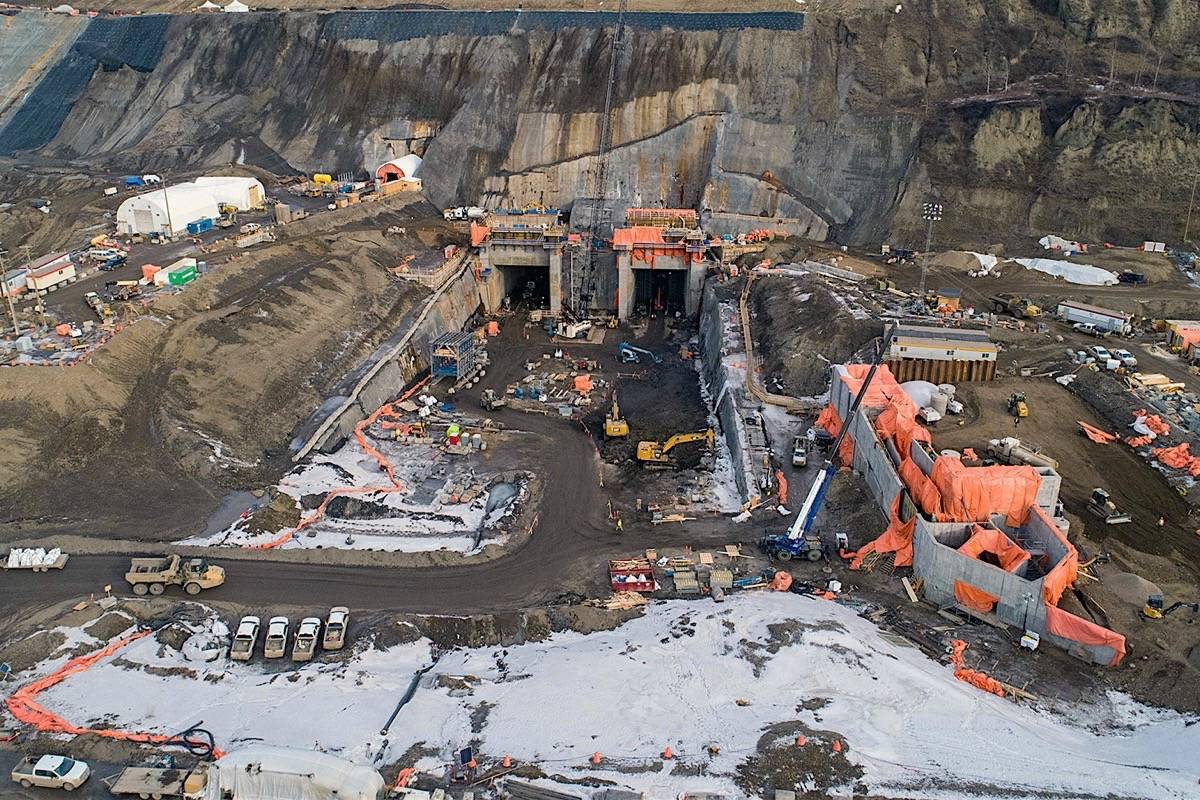 Diversion tunnels have been completed to redirect the Peace River during low water this summer, in one of the most critical steps to completing the Site C dam, March 2020. (BC Hydro)