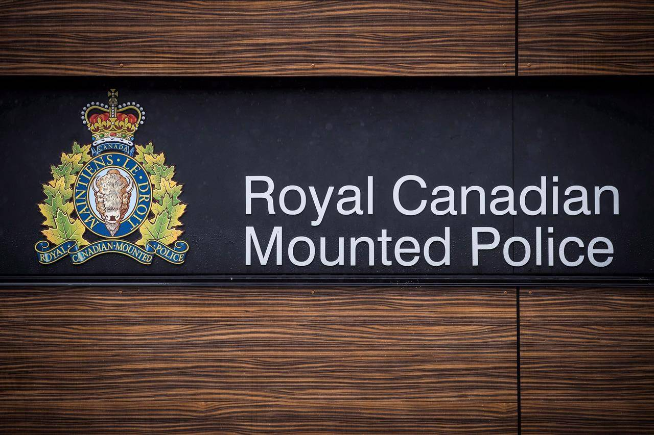 "The RCMP logo is seen outside Royal Canadian Mounted Police ""E"" Division Headquarters, in Surrey, B.C., on April 13, 2018. THE CANADIAN PRESS/Darryl Dyck"