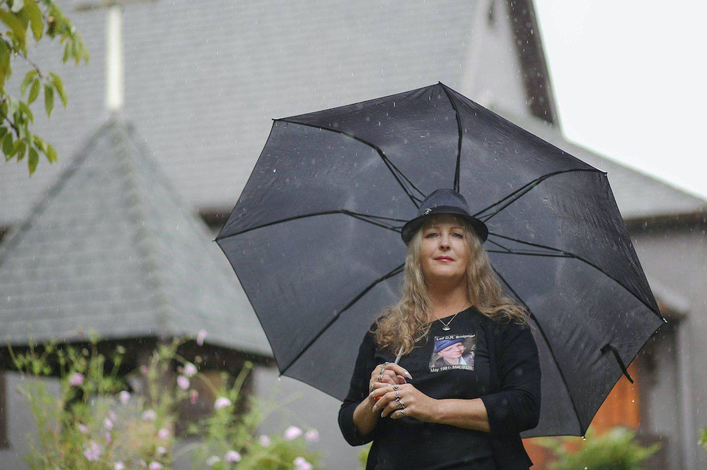 Donna Bridgman, wearing a shirt with son Leif's photo, outside St. Barnabas Church in New Westminster. Leif's ashes are in a burial niche at the church. Photo by Christopher Cheung.