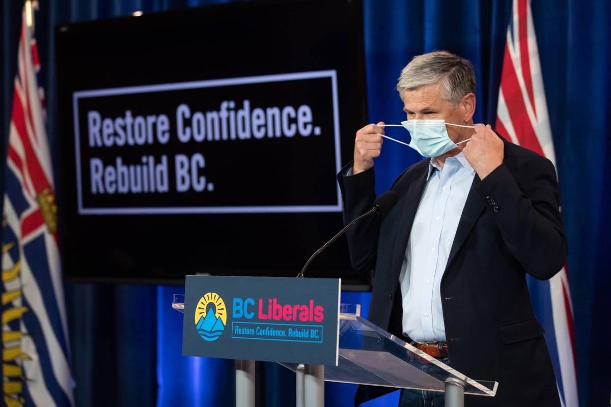 B.C. Liberal leader Andrew Wilkinson, a former doctor, doffs his facemask in the medical fashion before a campaign announcement in Vancouver, Sept. 26. (Darryl Dyck/The Canadian Press)