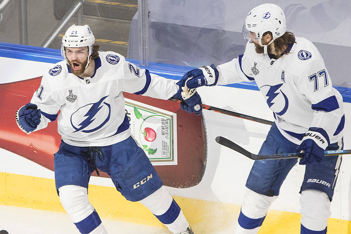 Tampa Bay Lightning's Brayden Point (21) celebrates his goal with Victor Hedman (77) against the Dallas Stars during first period NHL Stanley Cup finals action in Edmonton on Monday, September 28, 2020. THE CANADIAN PRESS/Jason Franson