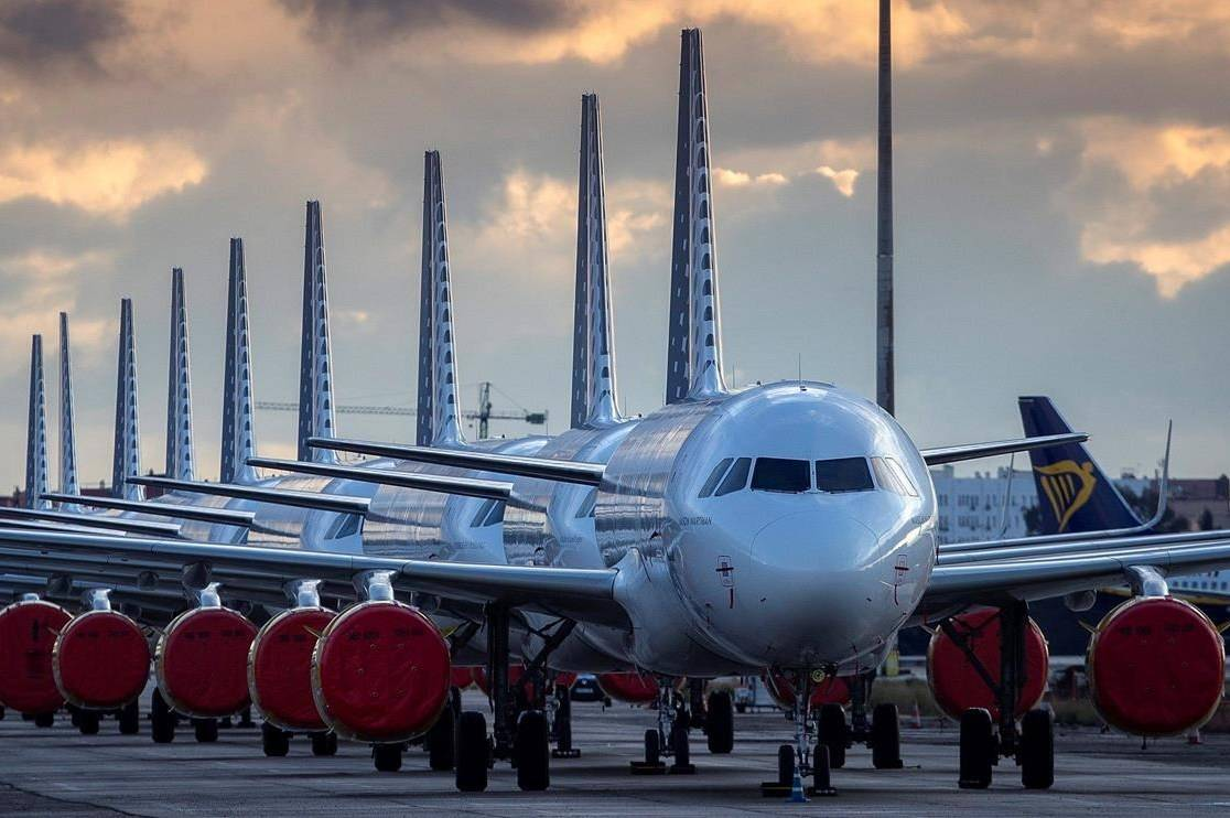 Vueling Airlines planes sit parked in a line at the Seville, Spain airport on Saturday, March 21, 2020, idled due to the COVID-19 coronavirus outbreak. THE CANADIAN PRESS/AP/Miguel Morenatti