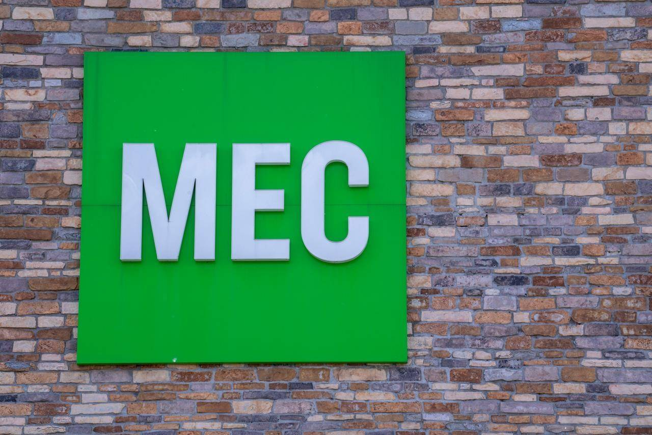 A Mountain Equipment Coop, MEC, sign is seen on a store front in Montreal on Tuesday, June 18, 2019. THE CANADIAN PRESS/Paul Chiasson
