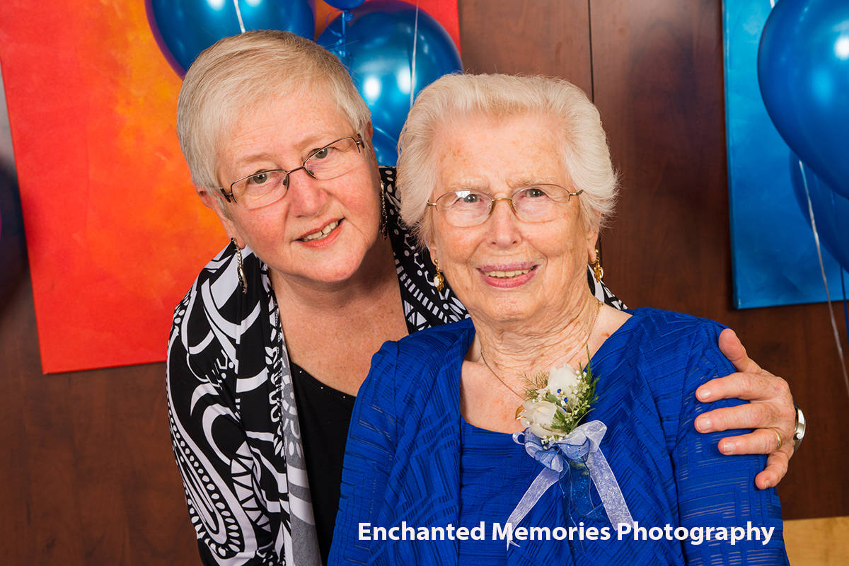 Edith Olson with her mother, Mary Foote, as Mary celebrated her 100th birthday. (Enchanted Memories Photography)