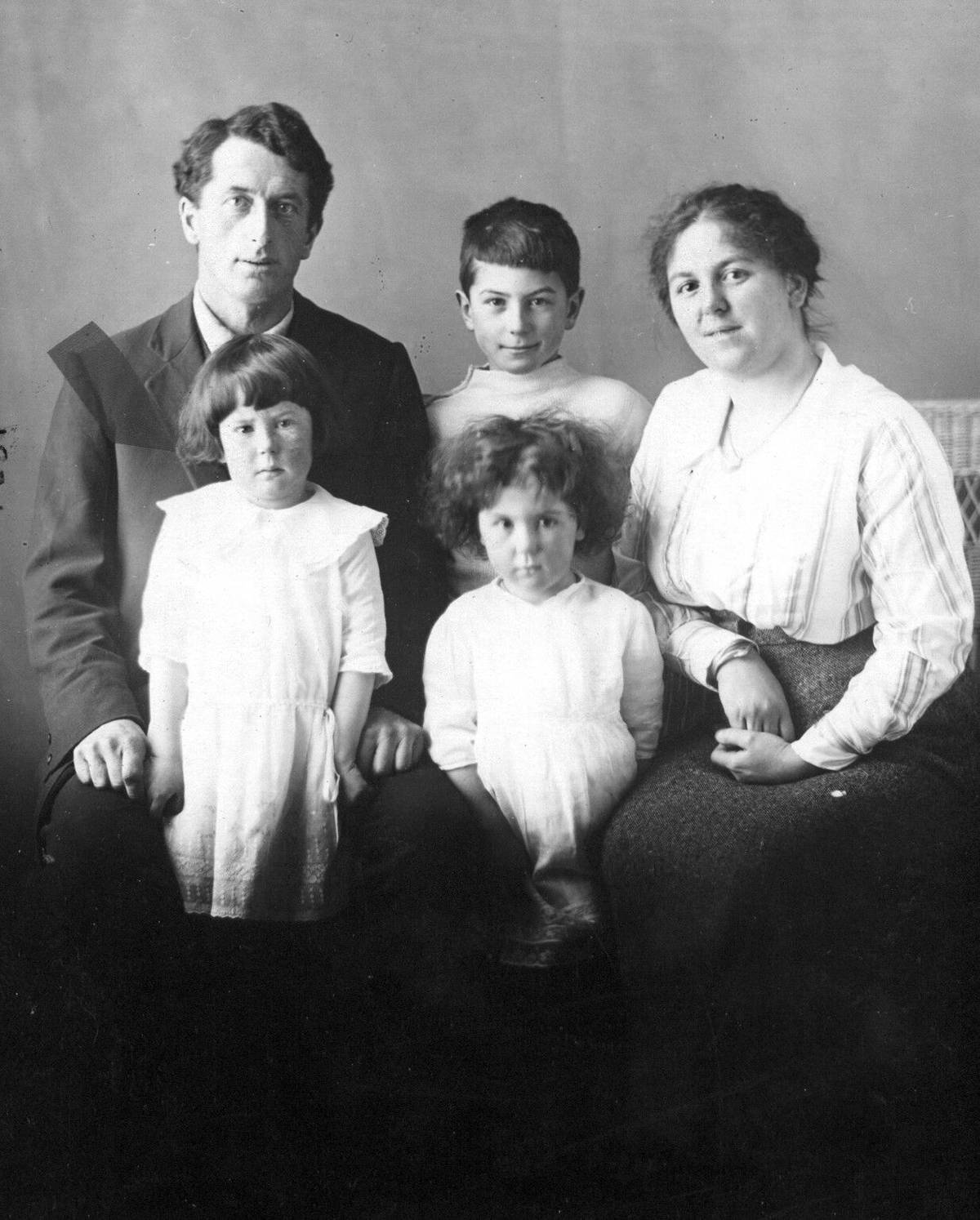 Mary (Hughes) Foote with her parents and siblings a century ago. She's standing in front of her father. (family photo)