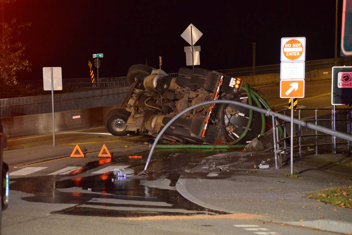 Emergency crews were called to the 7400-block of 232nd Street in Langley on Wednesday, Sept. 30, 2020 after a truck rolled over while navigating a roundabout. (Curtis Kreklau/Special to Langley Advance Times)