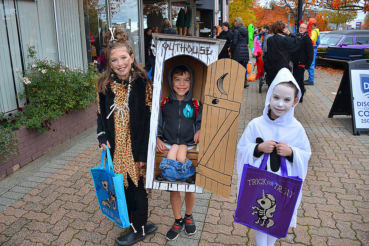 FILE – Halloween in Downtown Campbell River in 2019 had the streets crawling with young Trick or Treaters in costume like (from left) Summer, Lukas and Lola Knowles. Costume photos and prizes as well as other treats were offered by the Downtown BIA and its member businesses. (Photo by Alistair Taylor/Campbell River Mirror)