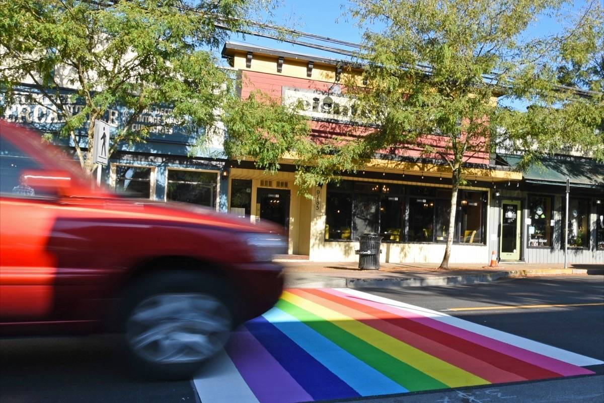 Fort Langley's rainbow crosswalk was installed in 2017. On Monday, Sept. 21, 2020, the Township has consented to one between the school district and RCMP buildings in Murrayville but Councillor Margaret Kunst has been the subject of criticism for not voting in favour. (Langley Advance Times file)