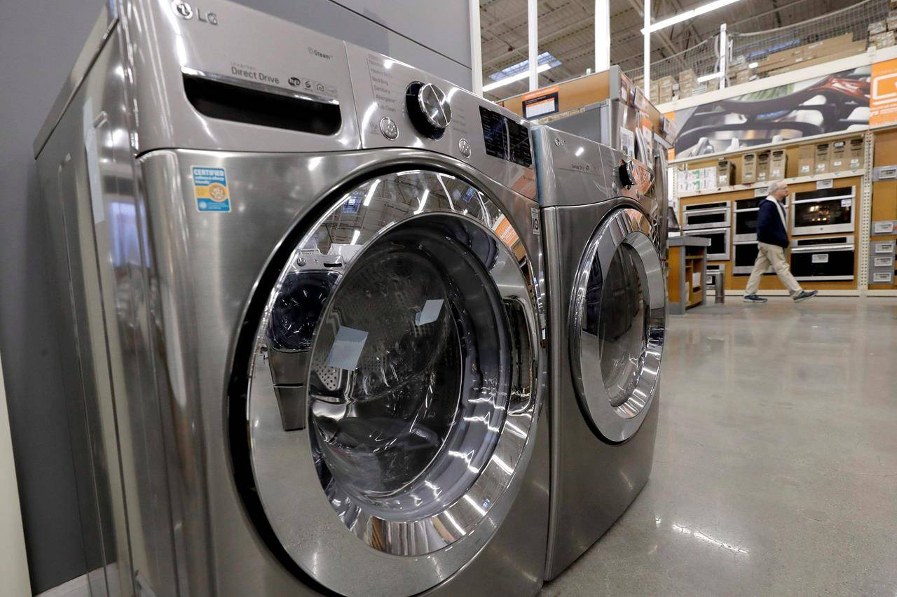A clothes washer, left, and dryer, centre, are on display at a Home Depot store location in Boston on January 27, 2020. THE CANADIAN PRESS/AP, Steven Senne