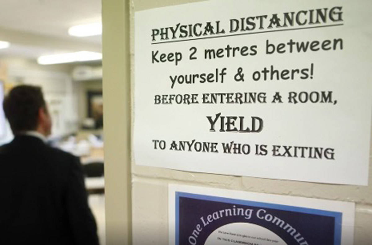 Sign outside of B.C. classroom amid ongoing pandemic. (The Canadian Press)