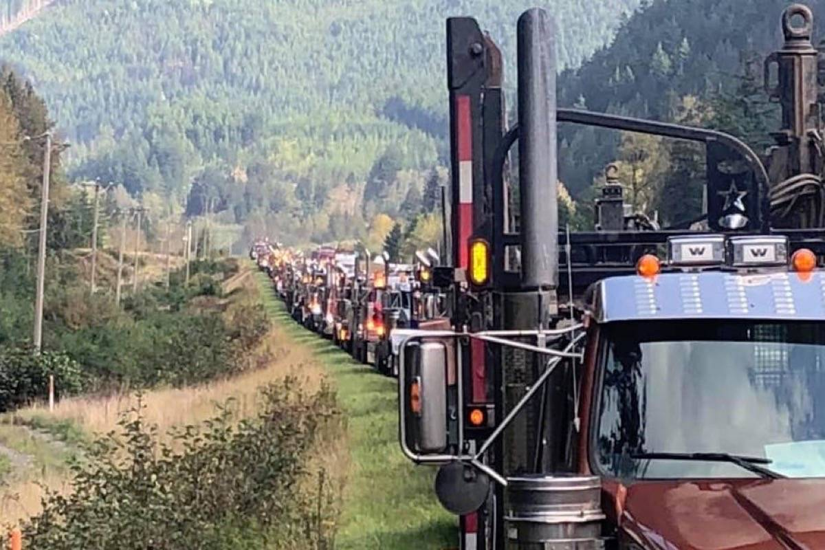 Logging trucks gather from around the B.C. Interior to head to downtown Vancouver for protest and meeting with NDP government officials at the Union of B.C. Municipalities convention, Sept. 27, 2019. (B.C. Logging Convoy/Facebook)